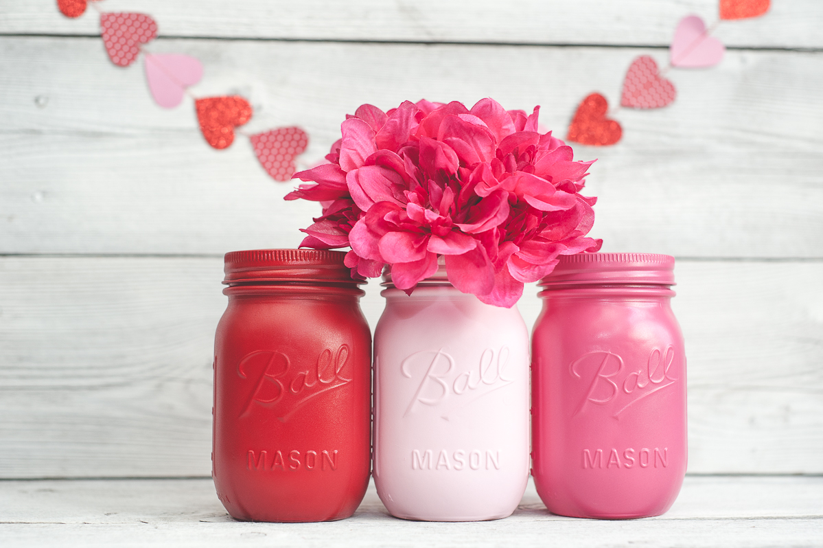 Pink and red painted mason jars.