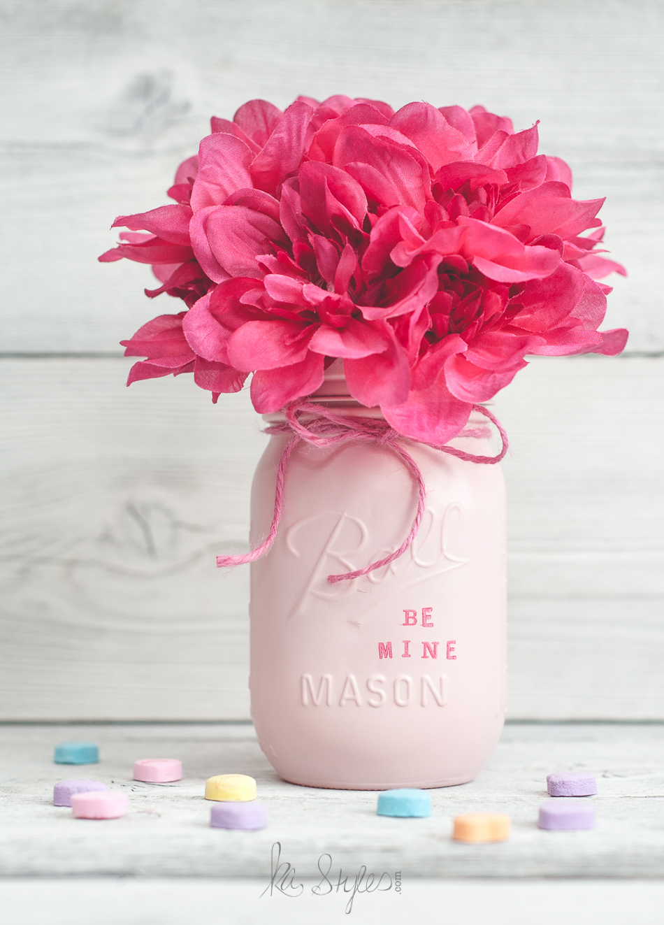 Quilted Ball mason jars spray painted with stamped Candy Heart sayings for Valentine's day. Fun decor vase, party favors or teachers gift.