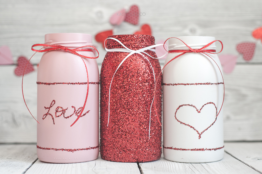 Glitter Valentine's Day mason jar vases for decor or gifts.