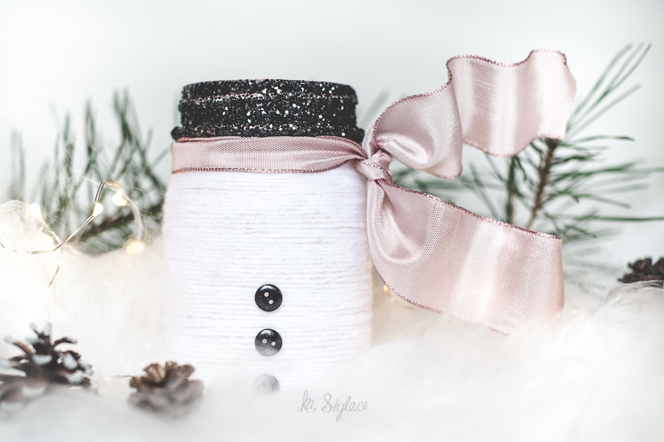 Yarn wrapped snowman mason jar luminary.