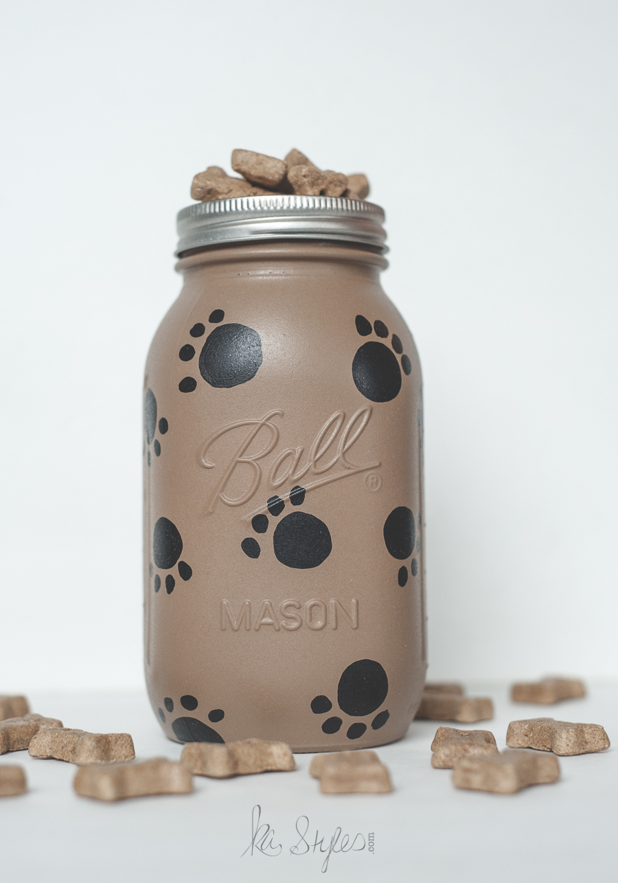 Paw print painted mason jar for dog treats.