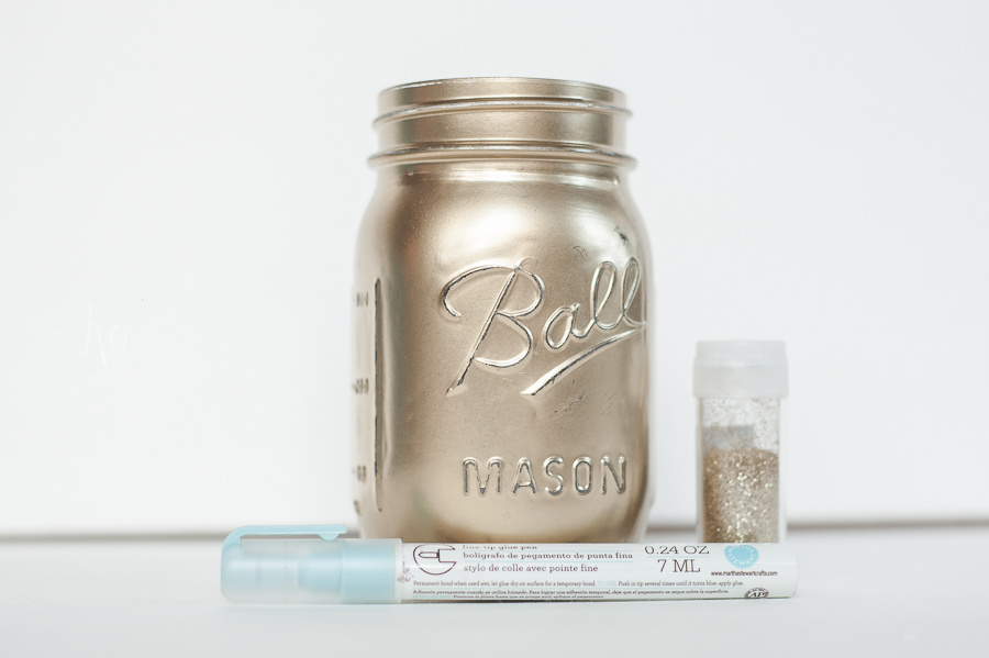 DIY Gold painted mason jar with gold glitter stars for Christmas or New Years. Cute luminary.