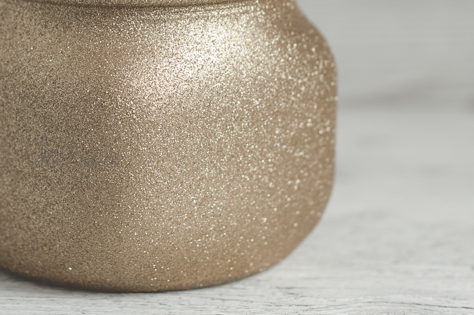 Gold spray glitter on mason jars.