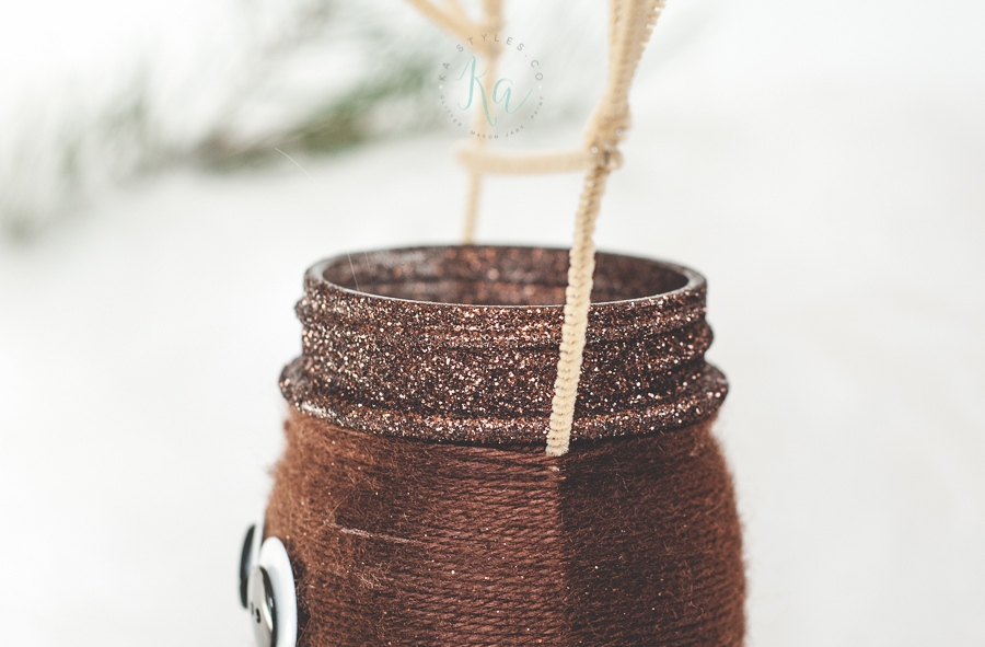 Yarn wrapped reindeer mason jar.