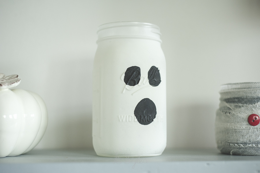 Glow in the dark spray paint ghost mason jar.