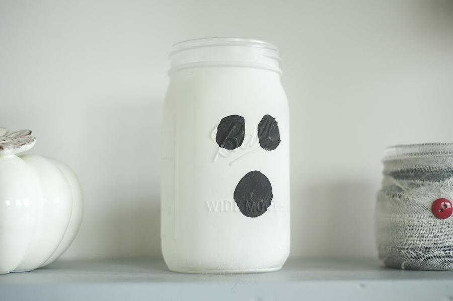 Glow in the dark spray paint ghost mason jar.