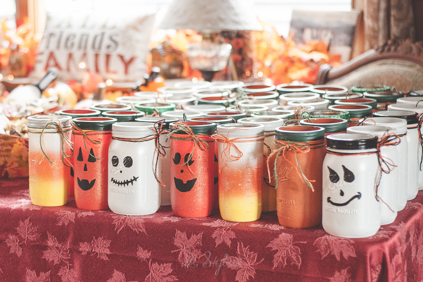 Halloween candy table. Candy corn, pumpkin and ghost mason jars.