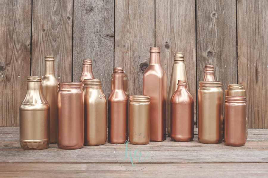 Painted glass bottles, copper and gold.
