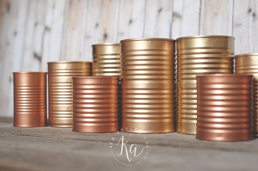 Copper and gold painted tin cans.