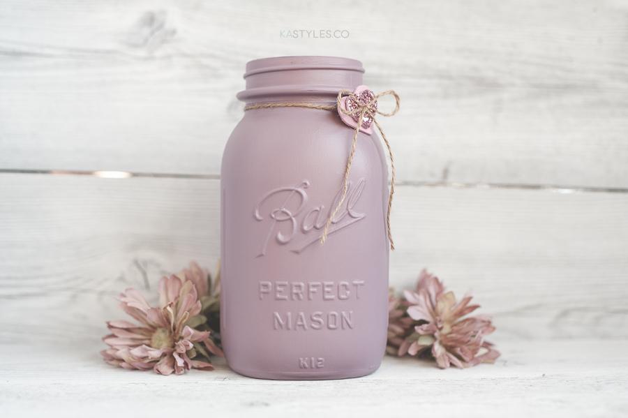 Latex painted vintage mason jars for Valentine's Day decor.
