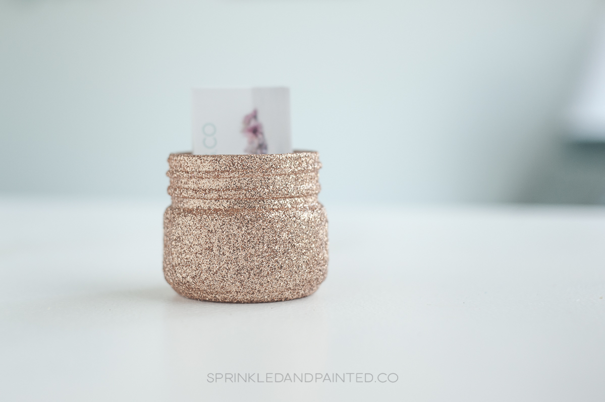 Rose gold business card holder.