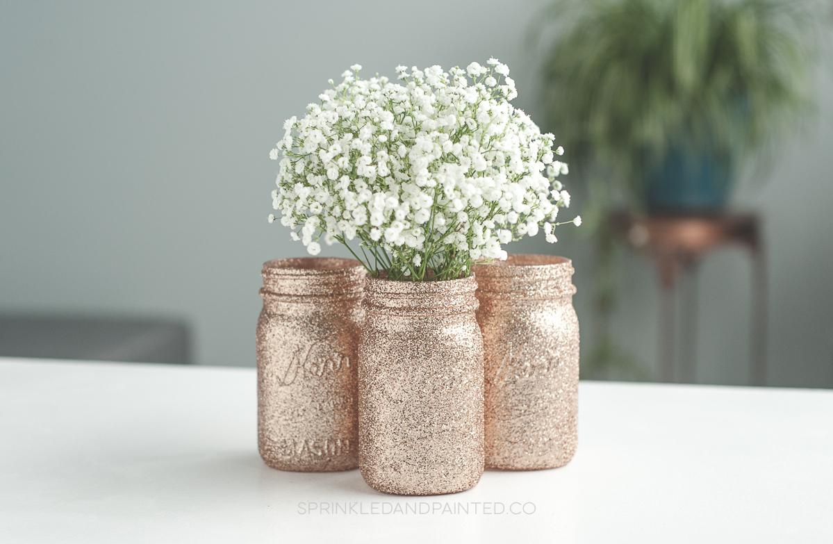 Rose gold wedding shower vases.