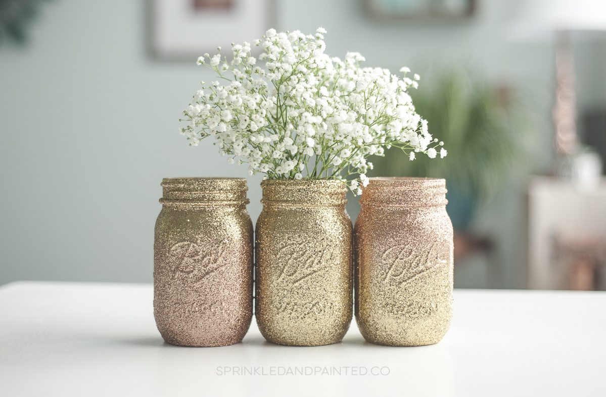 Rose gold and gold glitter vases.