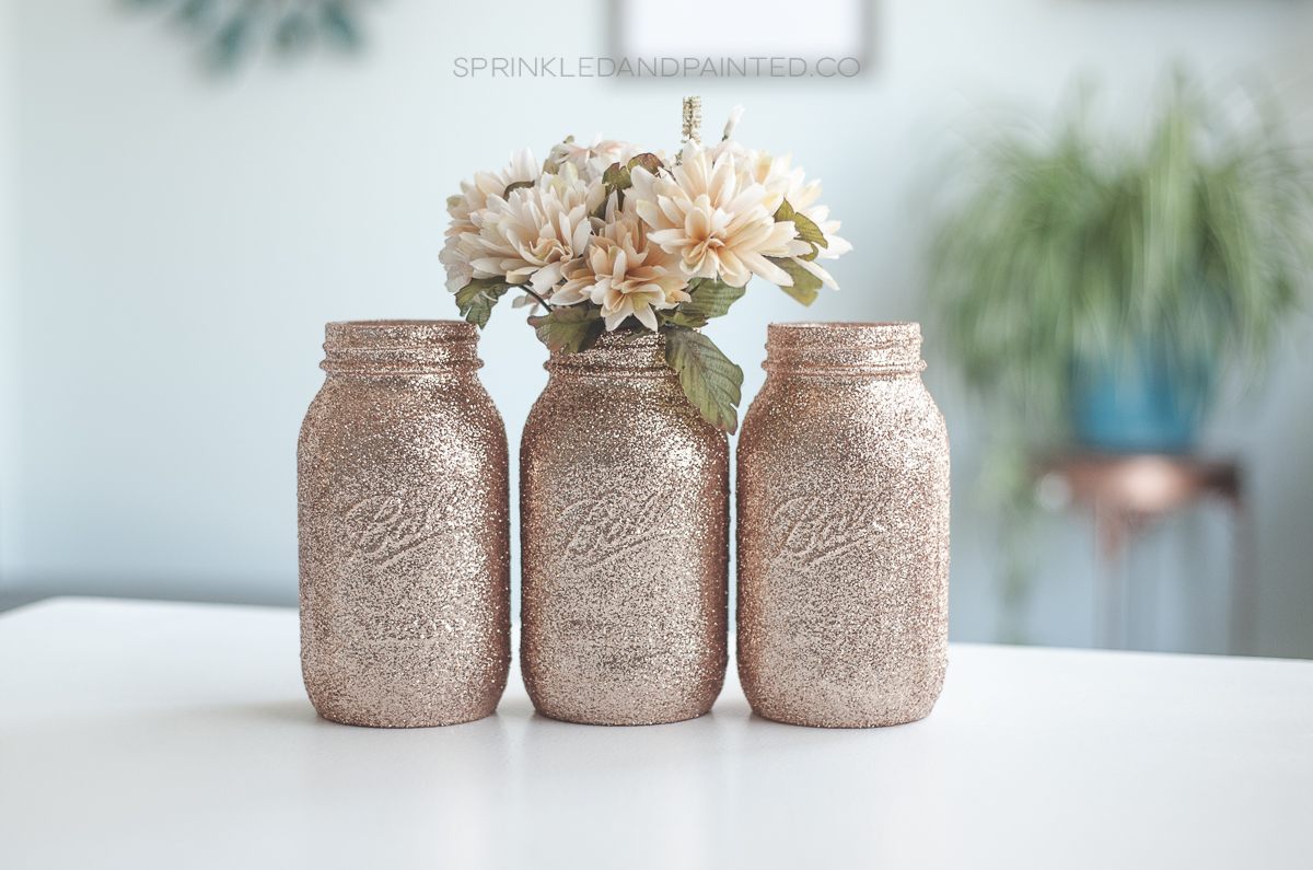Rose gold wedding vases, glitter mason jars.