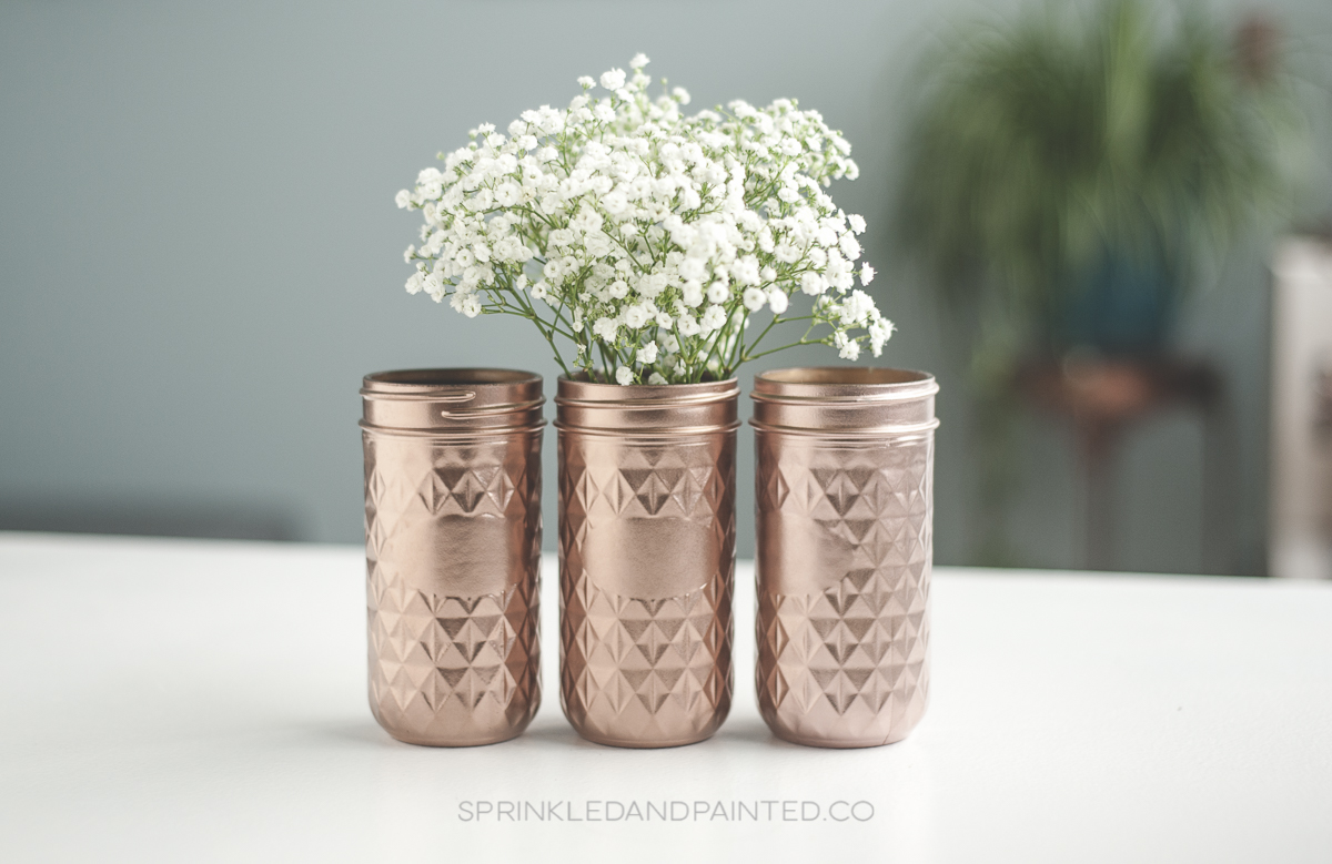 Rose gold vases, painted mason jars.