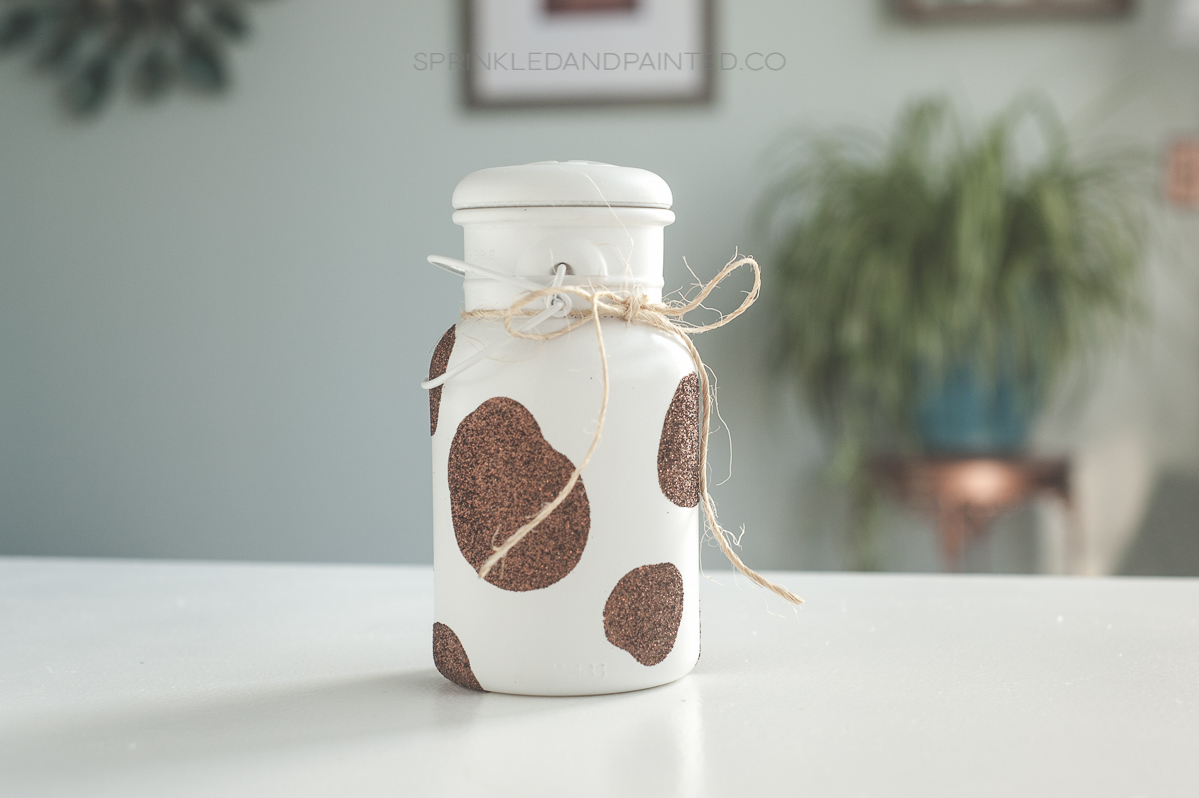 Cow mason jar vase with glitter spots.