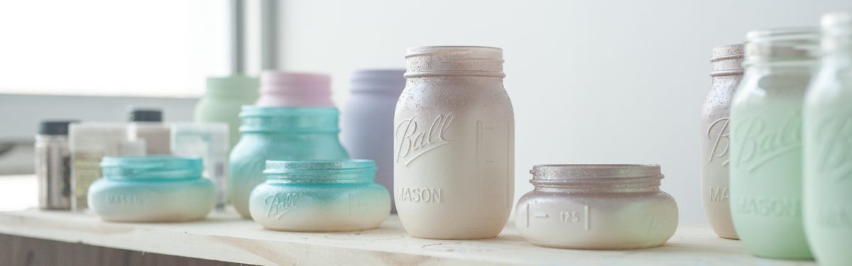 Buy painted and glittered mason jars.