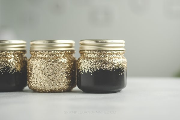 Black and gold makeup organizing jars. Glitter dipped.
