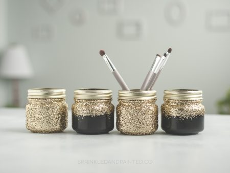black and gold makeup organizing jars.