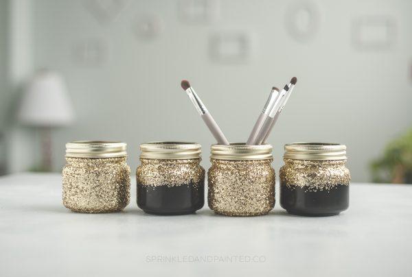 black and gold makeup organizing jars.
